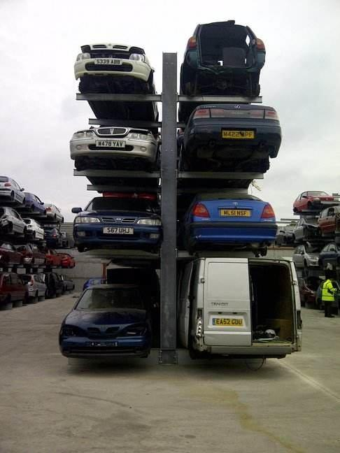 double sided cantilever racking at a scrap car yard. Cars stored on four levels