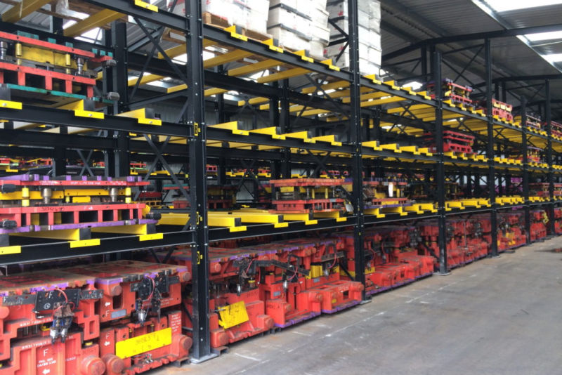 tools stored on fork entry bars of heavy duty racking