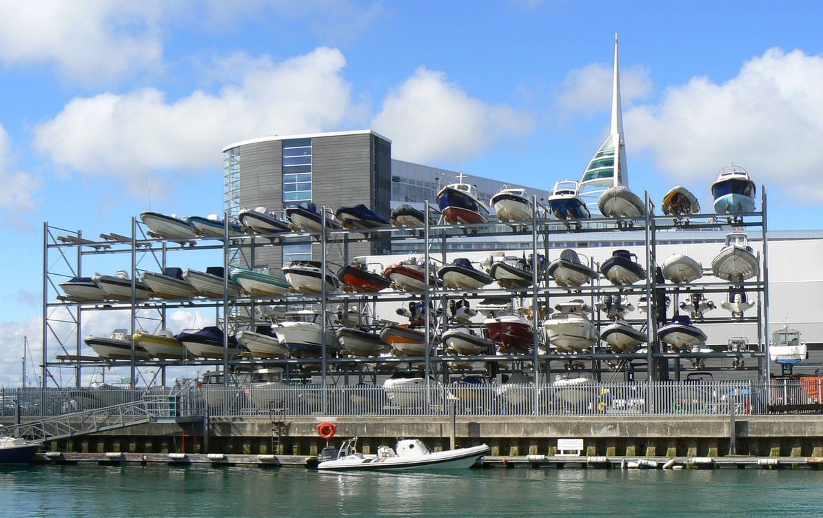 four tier dry stack boat rack full of boats.