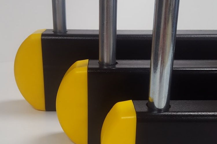 Cantilever arm retaining pins