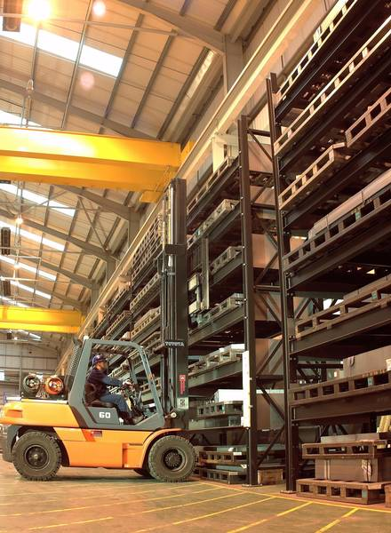 forklift truck loading heavy duty racks with tools